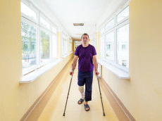 Man walks on crutches after arthroscopic surgery