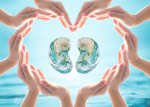 World Kidney Day design logo concept idea: Love heart shape symbolic sign of women human hands on blur blue turquoise clean aqua water background: Element of this image furnished by NASA